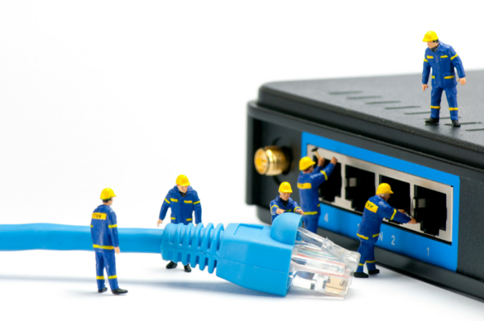 Miniature-Technicians-Connecting-Network-Cable
